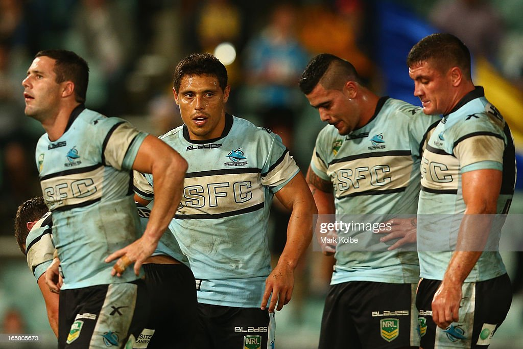 <a gi-track='captionPersonalityLinkClicked' href=/galleries/search?phrase=Anthony+Tupou&family=editorial&specificpeople=239499 ng-click='$event.stopPropagation()'>Anthony Tupou</a> of the Sharks and his team mates look dejected after defeat during the round five NRL match between the Parramatta Eels and the Cronulla Sharks at Parramatta Stadium on April 6, 2013 in Sydney, Australia.