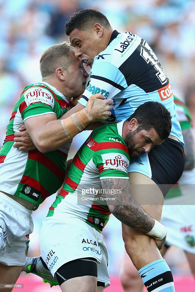 Anthony Tupou of the Sharks is tackled during the NRL Elimination Final match between the Cronulla Sharks and the South Sydney Rabbitohs at Allianz Stadium on September 13, 2015 in Sydney, Australia.
