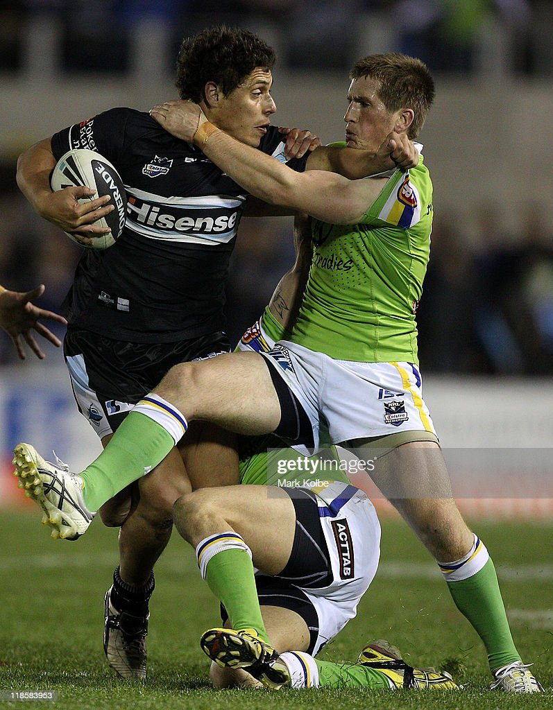Anthony Tupou of the Sharks is tackled during the round 18 NRL match between the Cronulla Sharks and the Canberra Raiders at Toyota Stadium on July 9, 2011 in Sydney, Australia.