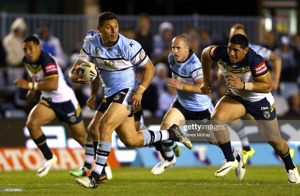 Anthony Tupou of the Sharks makes a break during the round 16 NRL match between the Cronulla Sharks and the North Queensland Cowboys at Remondis Stadium on July 18, 2014 in Sydney, Australia.