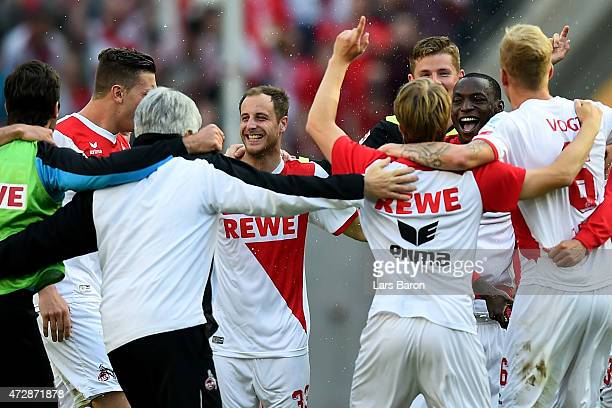 Anthony Ujah of 1FC Koeln celebrates with team mates after winning the Bundesliga match between 1 FC Koeln and FC Schalke 04 at RheinEnergieStadion...