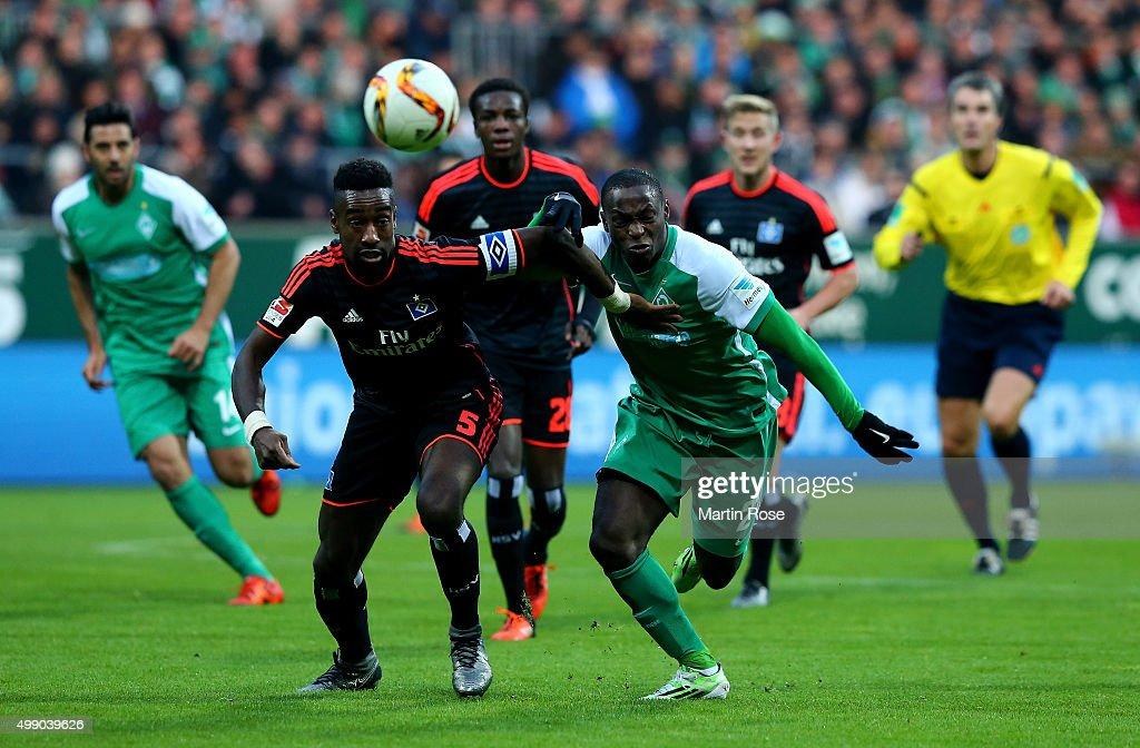Anthony Ujah of Bremen and Johan Djourou of Hamburg battle for the ball during the Bundesliga match between SV Werder Bremen and Hamburger SV at...