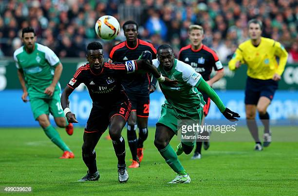 Anthony Ujah of Bremen and Johan Djourou of Hamburg battle for the ball during the Bundesliga match between SV Werder Bremen and Hamburger SV at...