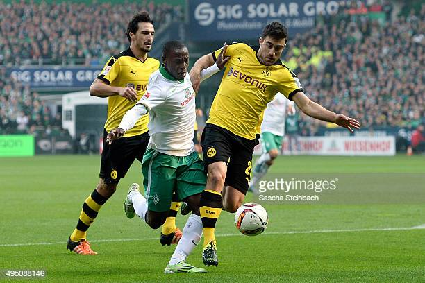 Anthony Ujah of Bremen battles for the ball with Mats Hummels and Sokratis of Dortmund during the Bundesliga match between Werder Bremen and Borussia...
