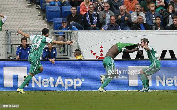 Anthony Ujah of Bremen celebrates after scoring his team's second goal with Claudio Pizarro and Fin Bartels during the Bundesliga match between 1899...