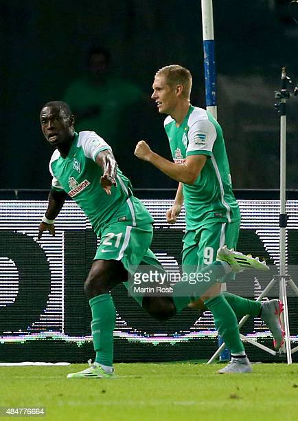 Anthony Ujah of Bremen celebrates after scoting the equalizing goal during the Bundesliga match between Hertha BSC Berlin and SV Werder Bremen at...
