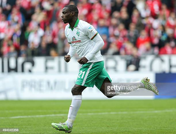 Anthony Ujah of Bremen celebrates his team's first goal during the Bundesliga match between 1 FSV Mainz 05 and Werder Bremen at Coface Arena on...