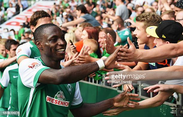 Anthony Ujah of Bremen celebrates with fans after the Bundesliga match between Werder Bremen and Borussia Moenchengladbach at Weserstadion on August...