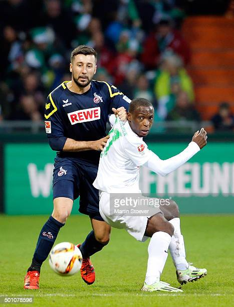 Anthony Ujah of Bremen challenges Dominic Maroh of Koeln during the Bundesliga match between Werder Bremen and 1 FC Koeln at Weserstadion on December...