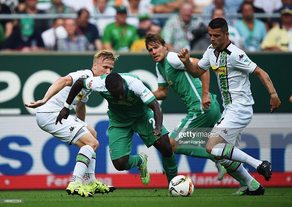 Anthony Ujah of Bremen is challenged by Granit Xhaka of Gladbach during the Bundesliga match between Werder Bremen and Borussia Moenchengladbach at...