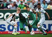 Anthony Ujah of Bremen is challenged by Granit Xhaka of Gladbach during the Bundesliga match between Werder Bremen and Borussia Moenchengladbach at...