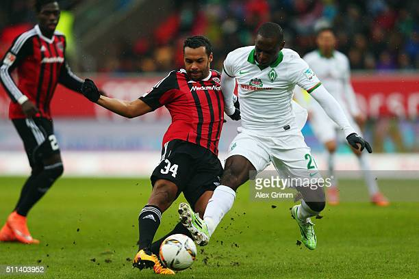 Anthony Ujah of Bremen is challenged by Marvin Matip of Ingolstadt during the Bundesliga match between FC Ingolstadt and Werder Bremen at Audi...