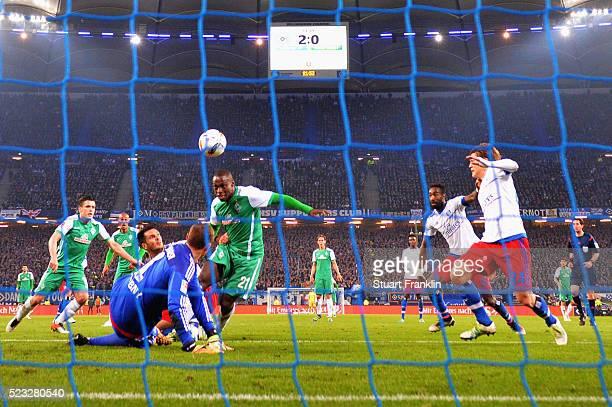 Anthony Ujah of Bremen scores his team's first goal against goalkeeper Jaroslav Drobny of Hamburg during the Bundesliga match between Hamburger SV...