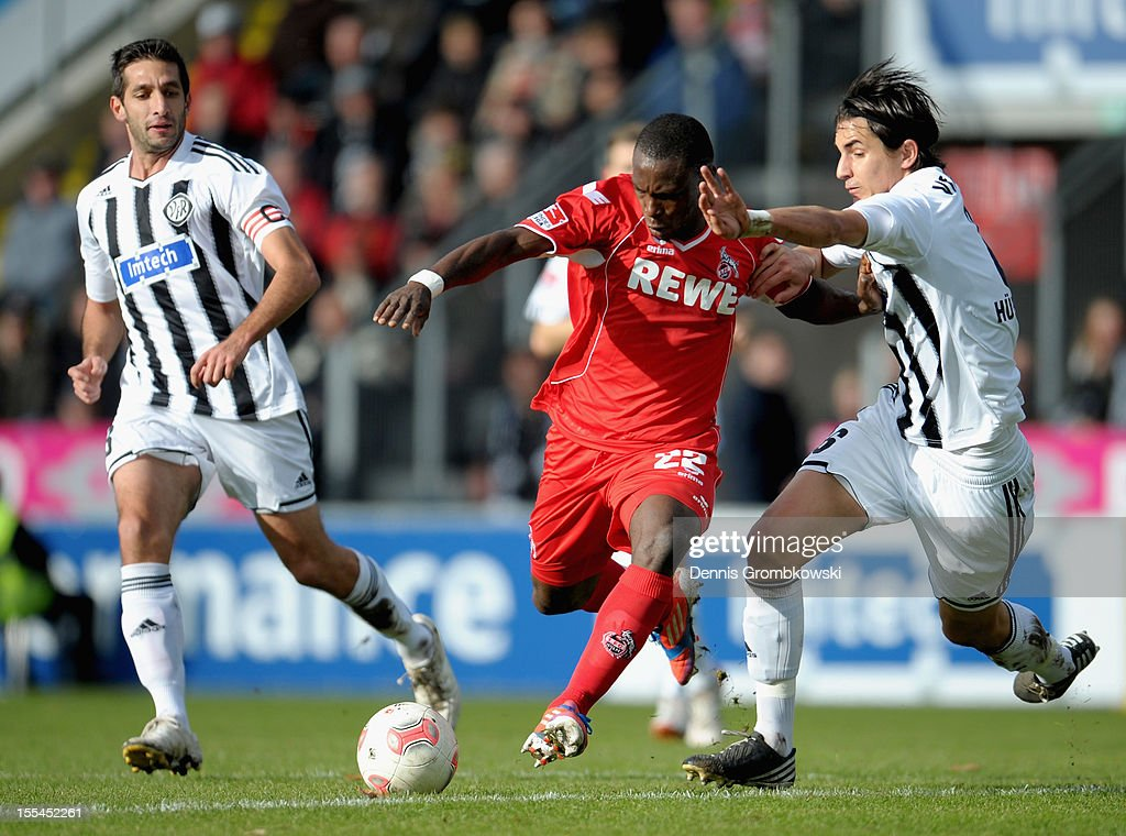 Anthony Ujah of Cologne and Benjamin Huebner of Aalen battle for the ball during the Second Bundesliga match between VfR Aalen and 1 FC Koeln at...