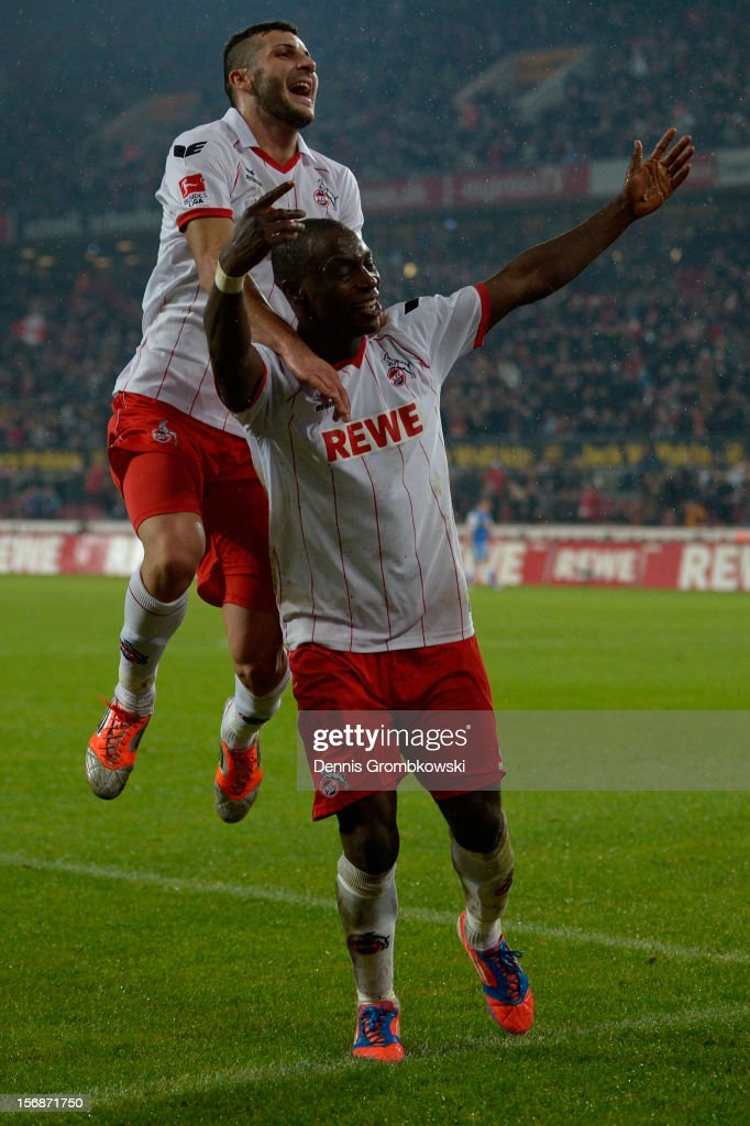 Anthony Ujah of Cologne celebrates with teammate Mikael Ishak after scoring his team's third goal during the Second Bundesliga match between 1. FC Koeln and VfL Bochum at RheinEnergieStadion on November 23, 2012 in Cologne, Germany.