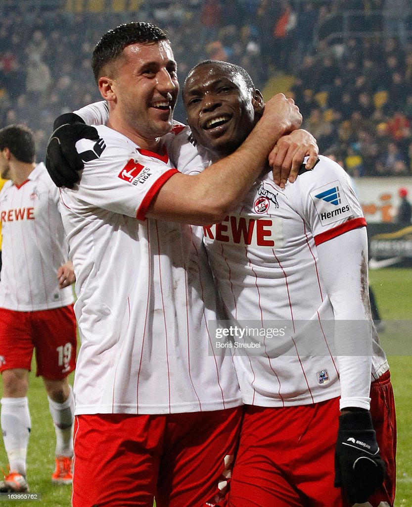 Anthony Ujah of Koeln celebrates his team's second goal with his team mate <a gi-track='captionPersonalityLinkClicked' href=/galleries/search?phrase=Dominic+Maroh&family=editorial&specificpeople=5633010 ng-click='$event.stopPropagation()'>Dominic Maroh</a> (L) during the Second Bundesliga match between SG Dynamo Dresden and 1. FC Koeln at Gluecksgas-Stadion on March 18, 2013 in Dresden, Germany.