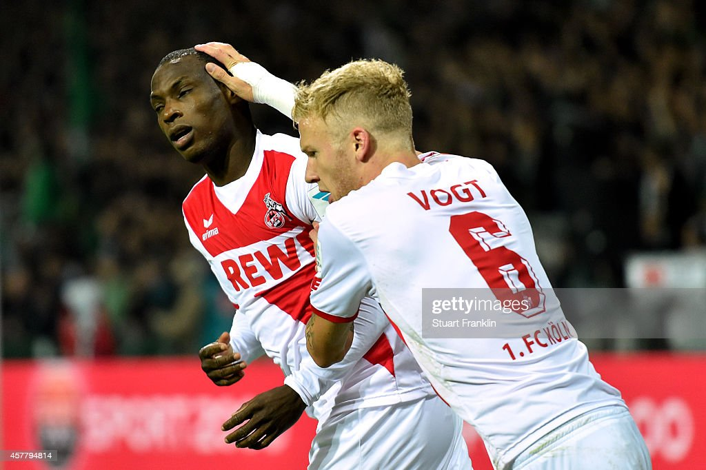 Anthony Ujah of Koeln celebrates with teammate Kevin Vogt #6 of Koeln after scoring the opening goal during the Bundesliga match between SV Werder Bremen and FC Koeln at Weserstadion on October 24, 2014 in Bremen, Germany.