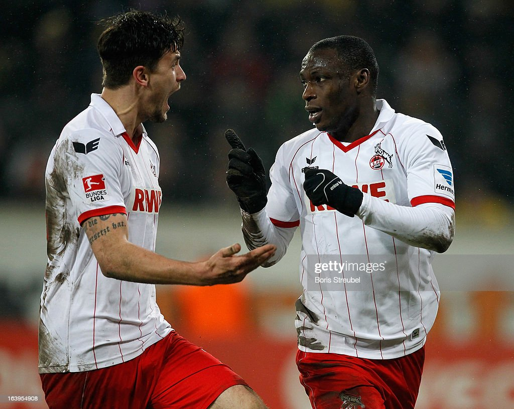 Anthony Ujah (R) of Koeln celebrates with team-mate Tobias Strobl after scoring the opening goal of the Second Bundesliga match between SG Dynamo Dresden and 1. FC Koeln at Gluecksgas-Stadion on March 18, 2013 in Dresden, Germany.