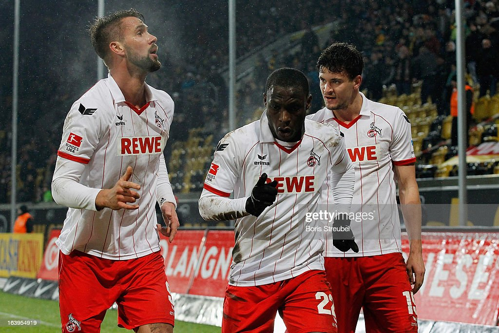 Anthony Ujah (C) of Koeln celebrates with team-mates <a gi-track='captionPersonalityLinkClicked' href=/galleries/search?phrase=Stefan+Maierhofer&family=editorial&specificpeople=750774 ng-click='$event.stopPropagation()'>Stefan Maierhofer</a> (L) and Mato Jajalo after scoring the opening goal of the Second Bundesliga match between SG Dynamo Dresden and 1. FC Koeln at Gluecksgas-Stadion on March 18, 2013 in Dresden, Germany.