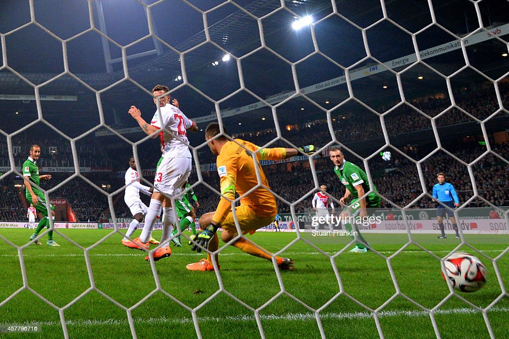 Anthony Ujah (2nd L) of Koeln scores the matchwinning goal past goalkeeper Raphael Wolf of Werder Bremen during the Bundesliga match between SV Werder Bremen and FC Koeln at Weserstadion on October 24, 2014 in Bremen, Germany.