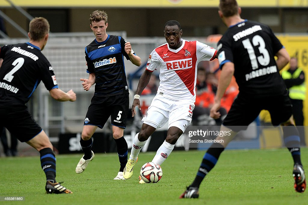 Anthony Ujah of Koeln vies with Uwe Huenemeier Patrick Ziegler and Christian Strohdiek of Paderborn during the Bundesliga match between SC Paderborn...