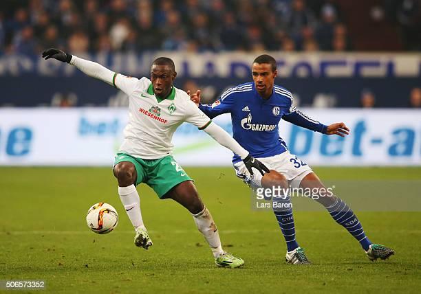 Anthony Ujah of Werder Bremen evades Joel Matip of Schalke during the Bundesliga match between FC Schalke 04 and Werder Bremen at VeltinsArena on...