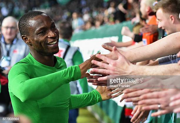 Anthony Ujah of Werder Bremen shakes hands with fans after a 62 victory in the Bundesliga match between Werder Bremen and VfB Stuttgart at...
