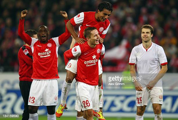 Anthony Ujah Sami Allagui Niko Bungert and Andreas Ivanschitz of Mainz celebrate after the Bundesliga match between FSV Mainz 05 and FC Bayern...