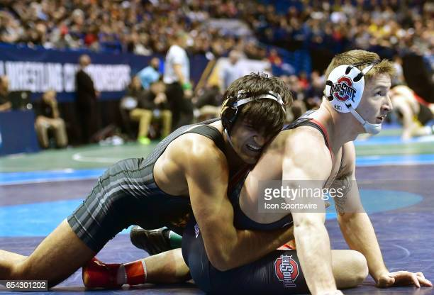 Anthony Valencia of Arizona State rides Cody Burcher of Ohio State in a 165pound match during the first round of the NCAA Wrestling Championships on...