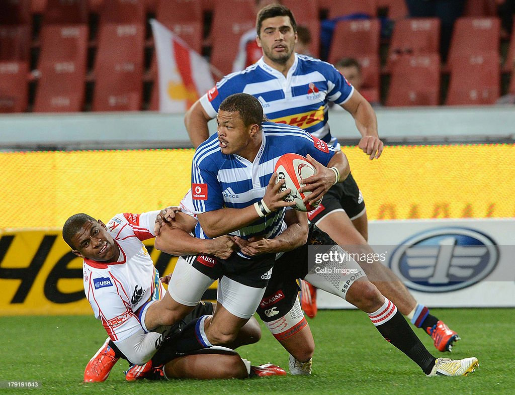 Anthony Volmink of the Lions tackles Juan de Jongh of the WP during the Absa Currie Cup match between MTN Golden Lions and DHL Western Province at...