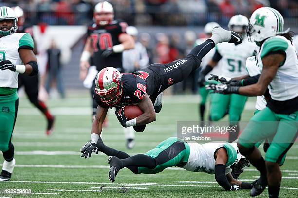 Anthony Wales of the Western Kentucky Hilltoppers gets tripped up while running with the ball against the Marshall Thundering Herd in the first half...