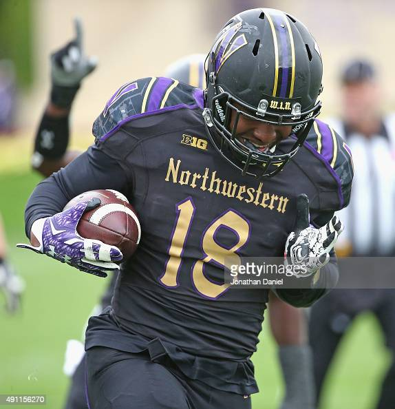 Anthony Walker of the Northwestern Wildcats runs the ball in for a touchdown after picking up a fumble against the Minnesota Golden Gophers at Ryan...