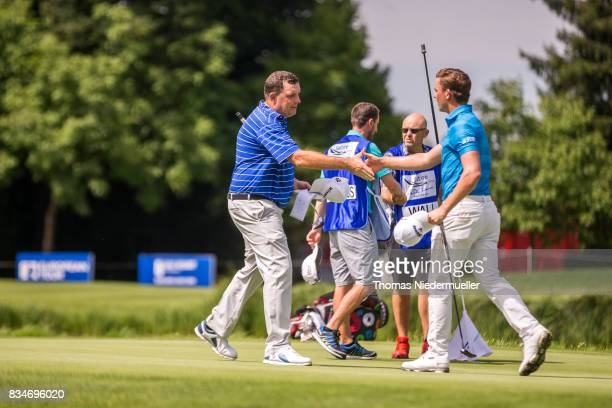 Anthony Wall of England and Haydn Porteous of South Africa shake hands during day two of the Saltire Energy Paul Lawrie Matchplay at Golf Resort Bad...