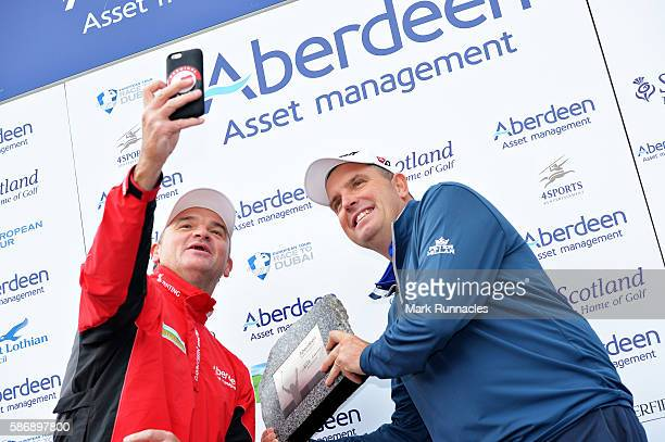 Anthony Wall of England gets a selfie with his winners trophy and tournament host Paul Lawrie of Scotland on day four of the Aberdeen Asset...