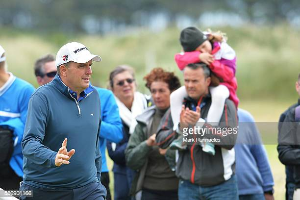 Anthony Wall of England reacts to the crowds applause after a good chip shot on hole 15 on day four of the Aberdeen Asset Management Paul Lawrie...