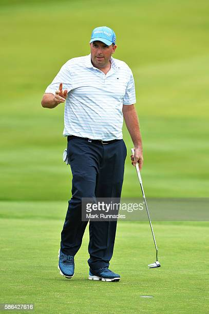 Anthony Wall of England reacts to the crowds applause after holing out on hole 18 on day three of the Aberdeen Asset Management Paul Lawrie Matchplay...