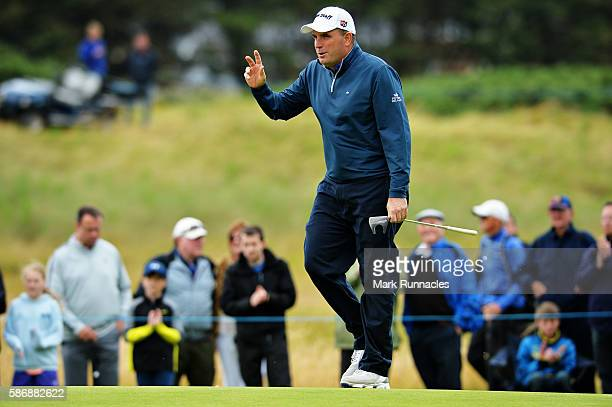 Anthony Wall of England reacts to the crowds applause after putting on hole 6 on day four of the Aberdeen Asset Management Paul Lawrie Matchplay at...