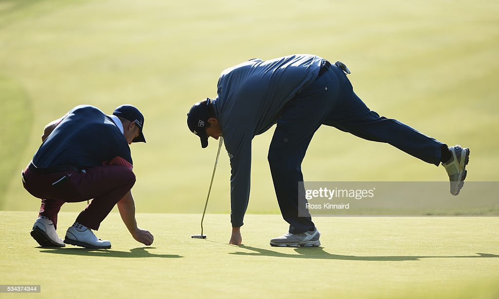 <a gi-track='captionPersonalityLinkClicked' href=/galleries/search?phrase=Anthony+Wall&family=editorial&specificpeople=243115 ng-click='$event.stopPropagation()'>Anthony Wall</a> of England retrieves his ball on the 1st green during day one of the BMW PGA Championship at Wentworth on May 26, 2016 in Virginia Water, England.