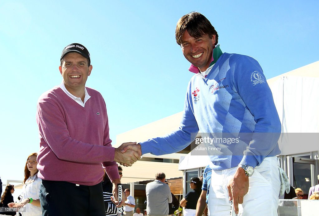 Anthony Wall of England shakes hands with RobertJan Derksen of Holland before their Genworth Putt for Charity challenge during round three of the...