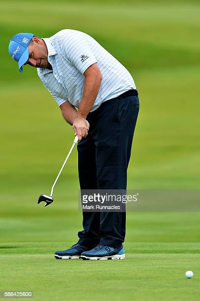 Anthony Wall of England takes a putt on the green on hole 18 on day three of the Aberdeen Asset Management Paul Lawrie Matchplay at Archerfield Links...