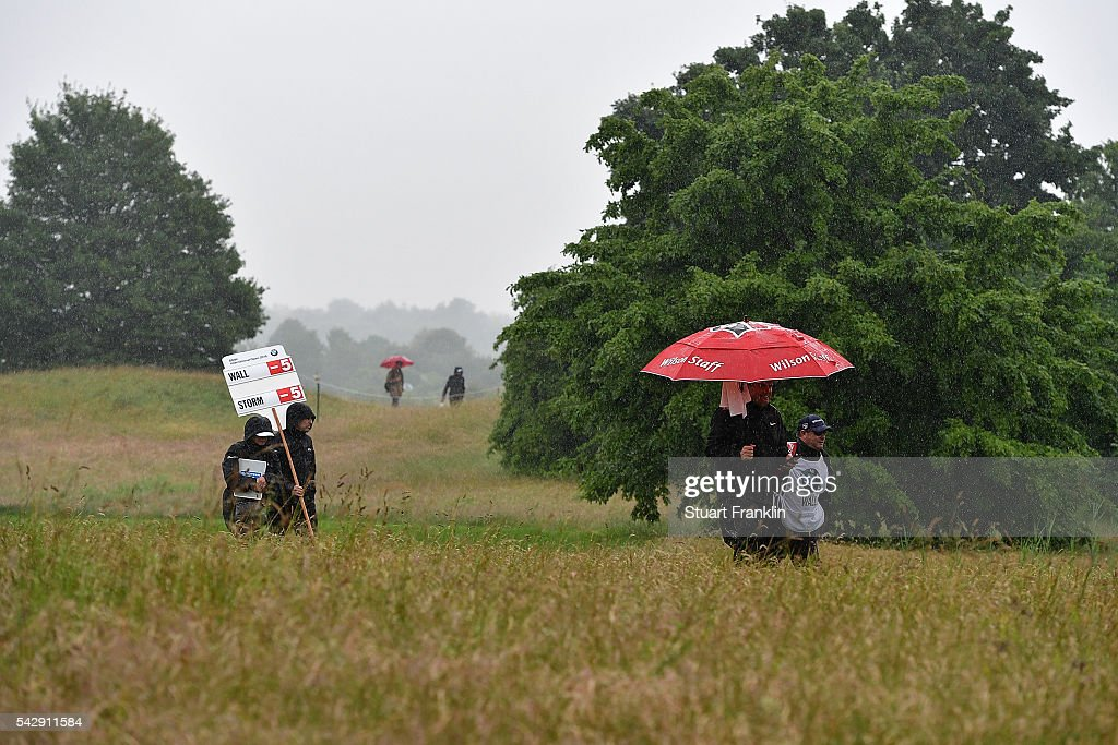 <a gi-track='captionPersonalityLinkClicked' href=/galleries/search?phrase=Anthony+Wall&family=editorial&specificpeople=243115 ng-click='$event.stopPropagation()'>Anthony Wall</a> of England walks in the rain with his caddie during the third round of the BMW International Open at Gut Larchenhof on June 25, 2016 in Cologne, Germany.