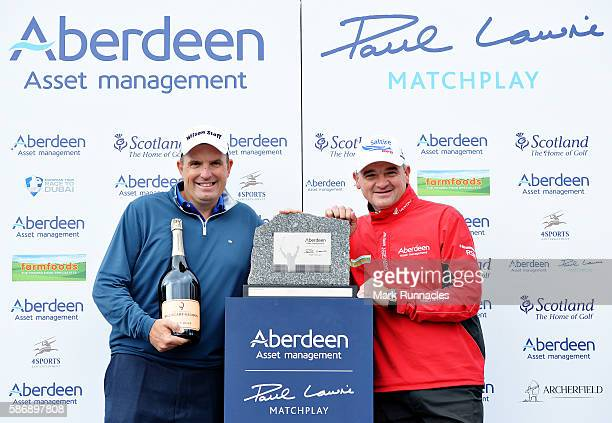 Anthony Wall of England with his winners trophy and tournament host Paul Lawrie of Scotland on day four of the Aberdeen Asset Management Paul Lawrie...