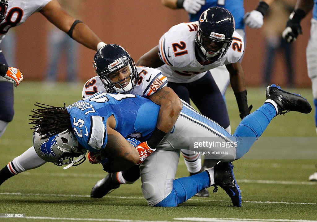 Anthony Walters #37 of the Chicago Bears tackles <a gi-track='captionPersonalityLinkClicked' href=/galleries/search?phrase=Mikel+Leshoure&family=editorial&specificpeople=5525934 ng-click='$event.stopPropagation()'>Mikel Leshoure</a> #25 of the Detroit Lions during the fourth quarter at Ford Field on December 30, 2012 in Detroit, Michigan. Chicago won the game 26-24.