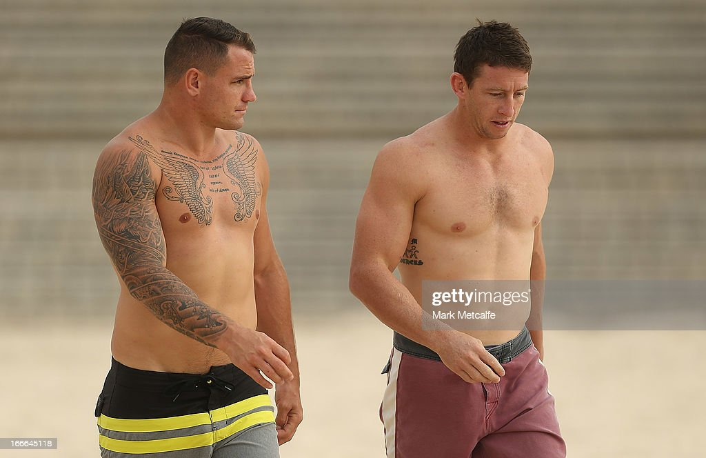 Anthony Watmough and Kurt Gidley walk to the ocean during an Australian Kangaroos training session at Coogee Beach on April 15, 2013 in Sydney, Australia.