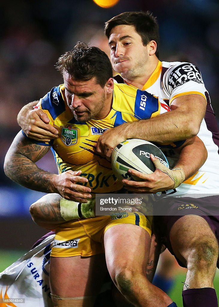 <a gi-track='captionPersonalityLinkClicked' href=/galleries/search?phrase=Anthony+Watmough&family=editorial&specificpeople=213919 ng-click='$event.stopPropagation()'>Anthony Watmough</a> of the Sea Eagles is tackled by the Broncos defence during the round 21 NRL match between the Manly-Warringah Sea Eagles and the Brisbane Broncos at Brookvale Oval on August 1, 2014 in Sydney, Australia.