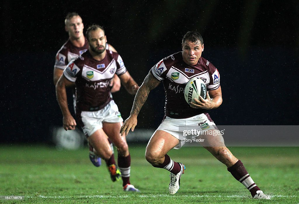 Anthony Watmough of the Sea Eagles runs with the ball during the round four NRL match between the Manly Sea Eagles and the Wests Tigers at Bluetongue Stadium on March 28, 2013 in Gosford, Australia.