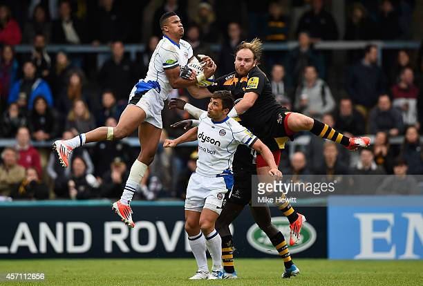 Anthony Watson and Gavin Henson of Bath and Andy Goode of Wasps compete for a high ball during the Aviva Premiership match between Wasps and Bath at...