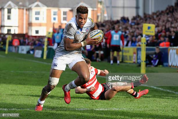 Anthony Watson of Bath breaks clear to score the first try during the Aviva Premiership match between Gloucester and Bath at Kingsholm Stadium on...