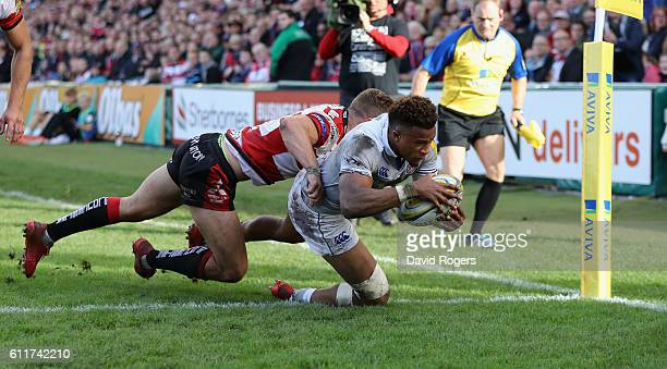 Anthony Watson of Bath dives over for the first try during the Aviva Premiership match between Gloucester and Bath at Kingsholm Stadium on October 1...