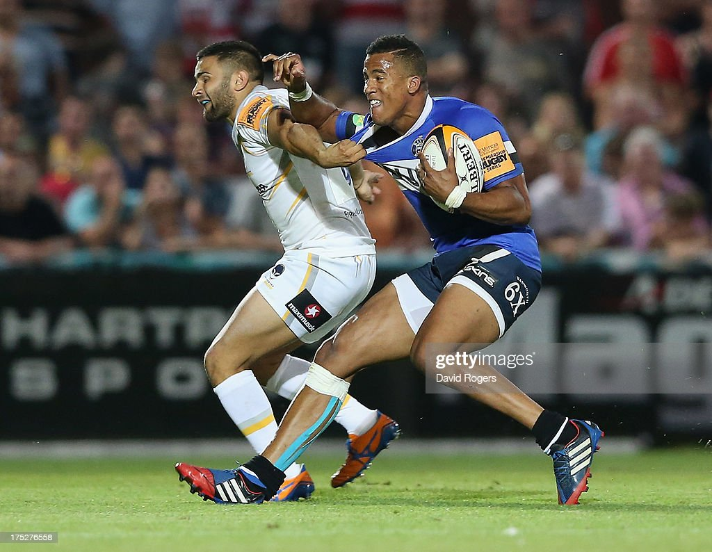 Anthony Watson of Bath is challenged by Tom Chapman of Worcester Warriors during the J.P. Morgan Asset Management Premiership Rugby 7's held at Kingsholm Stadium on August 1, 2013 in Gloucester, England.